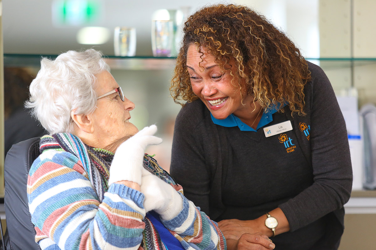 IRT carer smiling with elderly woman in retirement village