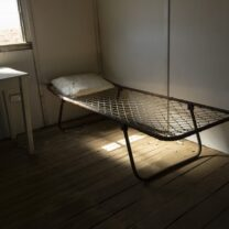 Bare stretcher in empty room leaves you feeling lonely