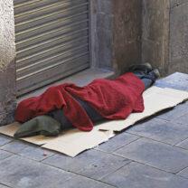 Homeless person sleeping on street